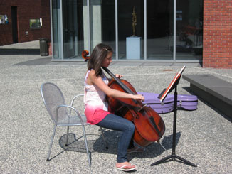 Girl playing cello outside